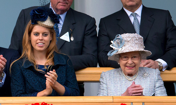 Like grandmother, like grandaughter: Princess Beatrice of York and Queen Elizabeth II applaud in sync at the QIPCO British Champions Day meet at Ascot Racecourse on Oct. 20, 2012 in England.