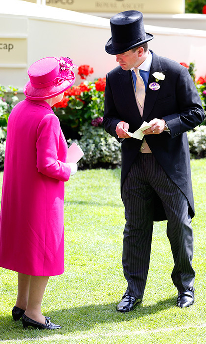Making a dapper pair with grandson Peter Phillips as they watch the horses in the parade ring at Ascot Racecourse on June 20, 2014.