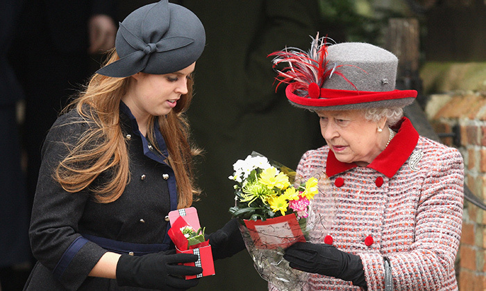 Princess Beatrice helps her grandmother Queen Elizabeth sort out gifts from wellwishers at the Christmas Day church service at St Mary's Church on December 25, 2008 in Sandringham, England.