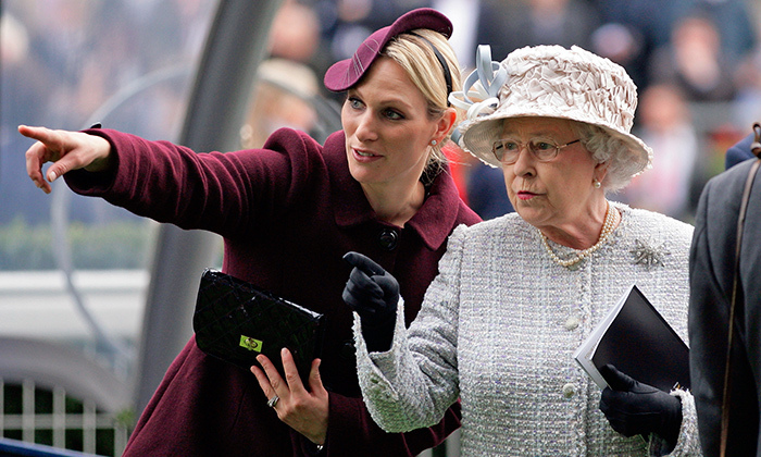 Something has clearly caught the attention of Zara Phillips and her royal grandmother at the QIPCO British Champions Day meet at Ascot Racecourse on Oct. 20, 2012.