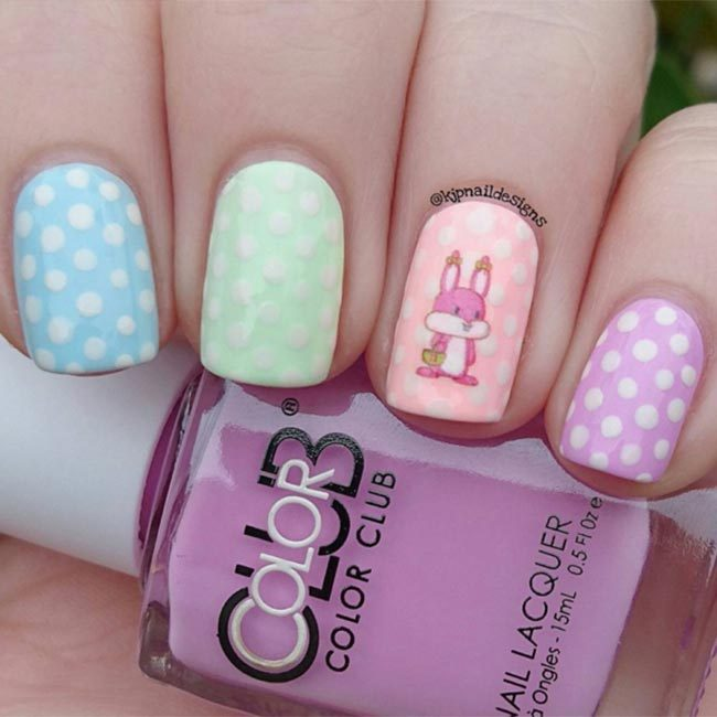 @kjpnaildesigns used a nail decal to add this adorable Easter bunny detail to her pastel and polka dot style.
