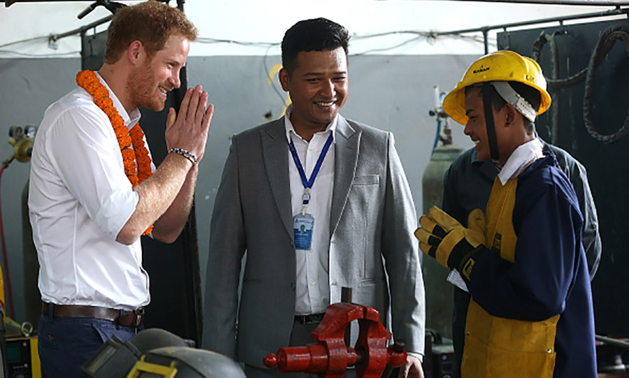 Prince Harry greeted a student during his visit to the Samo Thimi Technical School in Bhaktapur.