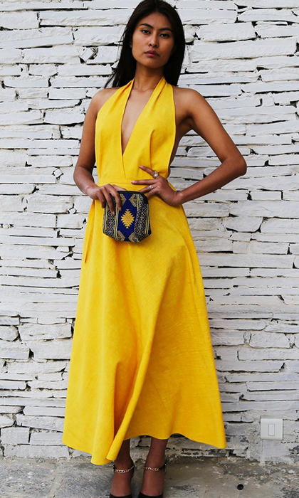 The Duchess of Cambridge isn't afraid to add a little pop of colour to her wardrobe, and with the arrival of spring already in her wake this yellow halter dress by Bhutanese designer Chimmi Choden is a ray of sunshine. 