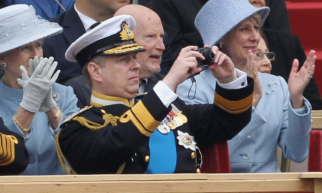May 2012: Prince Andrew grabbed his camera to capture a moment from the Armed Forces Parade in England.