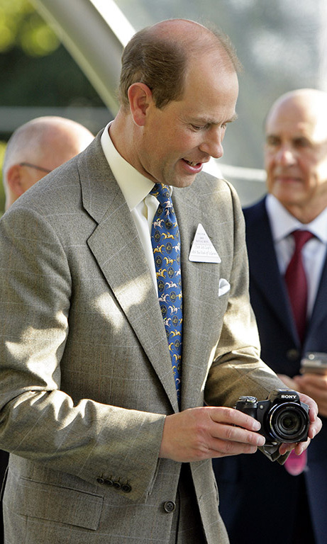 September 2009: Is this thing on? Prince Edward fixed a camera before presenting it to the winning trainer during the Ascot Festival in London.