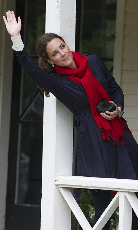 July 2011: The Duchess of Cambridge, a passionate photographer, clutched her camera and waved as Prince William participated in a helicopter exercise at Dalvay lake in Charlottetown, Canada.