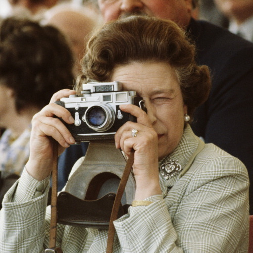 May 1982: Say cheese! Queen Elizabeth was a pro photographer during the The Windsor Horse Show.