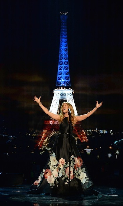 "At the 2015 American Music Awards, Celine Dion delivered an enchanting rendition of Edith Piaf's ""Hyme a l'amour"" in honour of those affected by the Paris terrorist attacks. Dressed in a black floral ball gown and accompanied by a full orchestra, the singer captivated the solemn audience as she paid tribute to the tragic events that befell France on Nov. 13. (Photo: © Getty)"