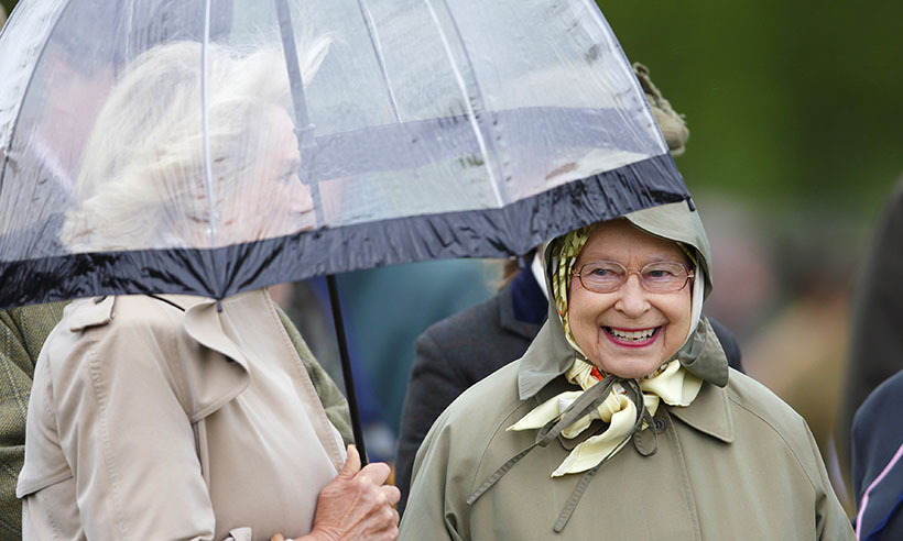 While the Queen warded off the mist with a headscarf, the Duchess of Cornwall watched all the action at the Royal Windsor Horse in 2013 under the protection of a clear umbrella. 