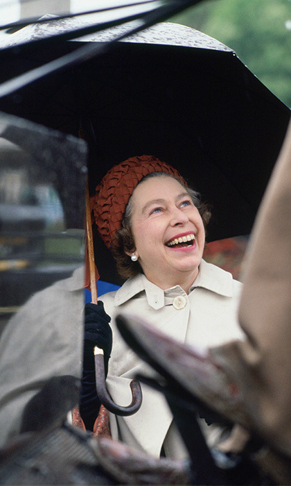 A little rain did little to damper Her Majesty's spirits at the Royal Windsor Horse Show in 1978. 