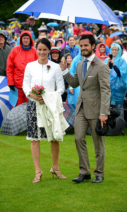"Umbrellas hold a special meaning in the hearts of Prince Carl Philip and Princess Sofia. The royal couple, seen here in July 2014, famously included a moving rendition of Rihanna's hit song ""Umbrella"" during their wedding service in 2015.     