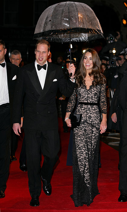 Taking a cue from the Queen, the Duke and Duchess of Cambridge made sure their brolly matched their stunning formal wear at the London premiere of <i>War Horse</i> in 2012. 