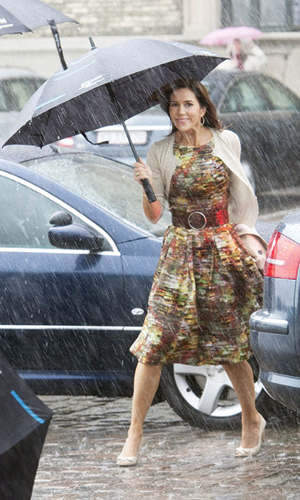 Even in a downpour, Princess Mary of Denmark looked super chic in a belted print dress when arriving for a luncheon in Copenhagen in 2009. 