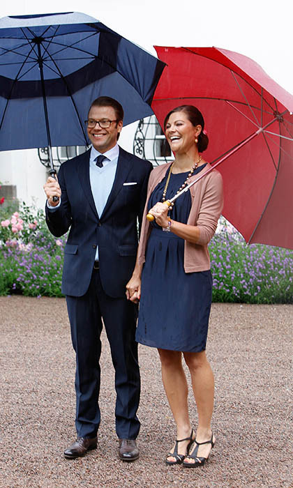 Sweden's Prince Daniel and Crown Princess Victoria opted for his and hers umbrellas at the future queen's birthday celebrations in July 2011. 