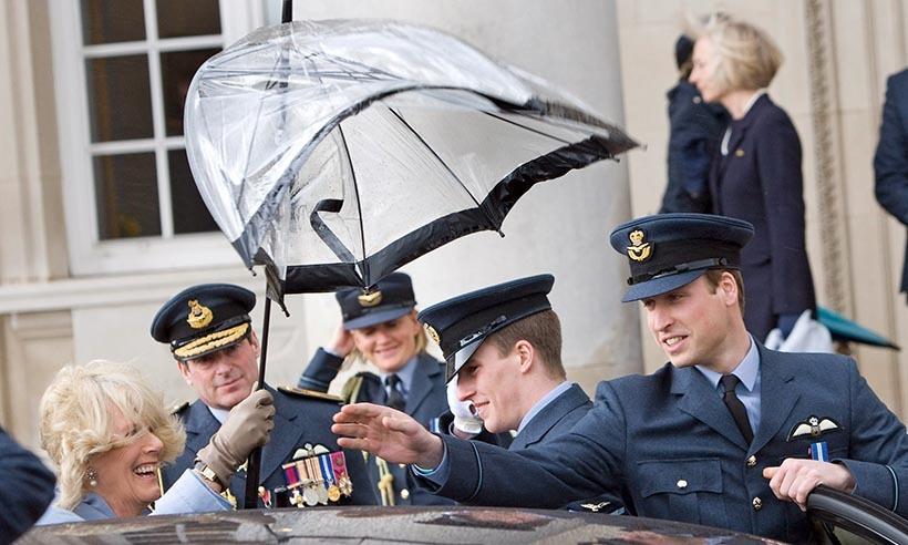 Prince William comes to the rescue of the Duchess of Cornwall, whose umbrella battled high winds at a RAF event in 2008. 