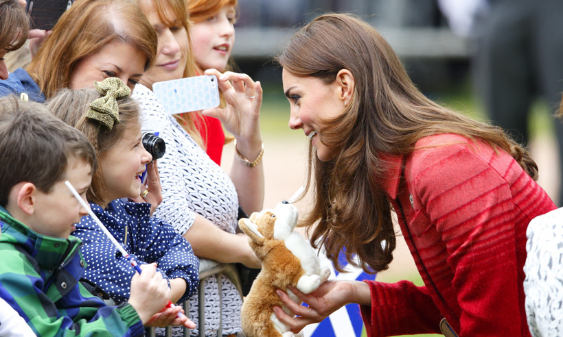 This young spectator knows her royal trivia! Kate was delighted to receive a stuffed corgi toy, the Queen's favourite breed, while on a walkabout in Strathearn in 2014. 