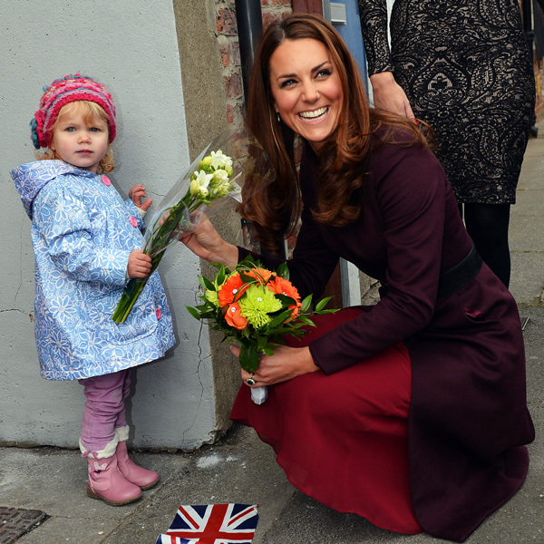 """Are these for me?"" Kate shared a giggle with crowds outside of the CRI Stockton Recovery Service when this adorable little girl, two-year-old Lola, refused to let go of her daffodils. 