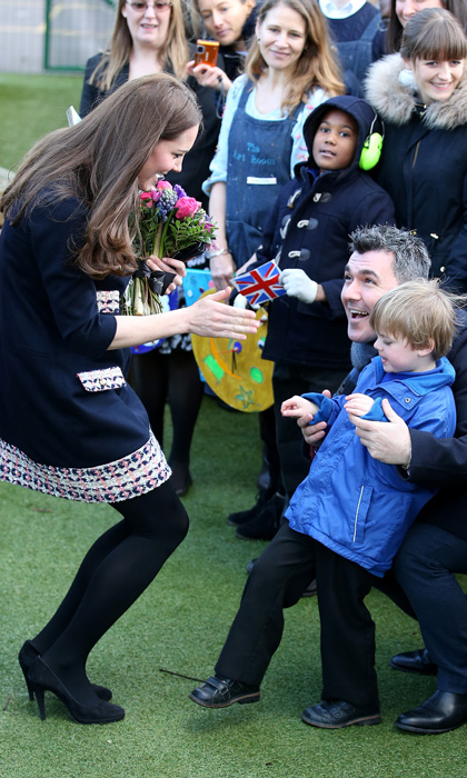 Kate was inundated with flowers and happy faces when she visited Barlby Primary School in London in 2015. 