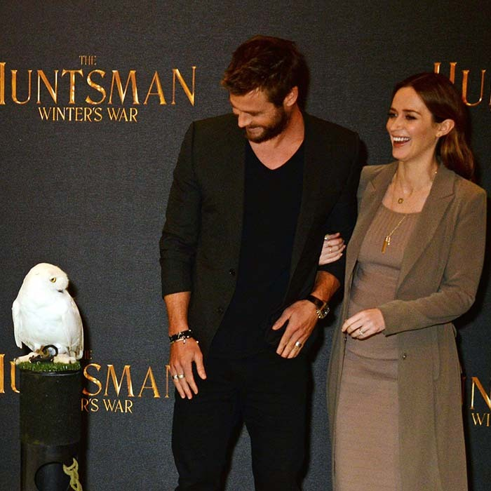 Mom-to-be (for the second time!) Emily Blunt kept a tight hold on her <i>The Huntsman: Winter's War</i> co-star Chris Hemsworth at the movie's owl-filled premiere in London. 