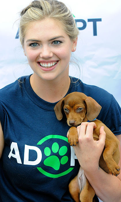 Kate Upton is used to having all eyes on her, but the model happily let this adorable little puppy looking for a forever-home shine at a dog adoption event in Lakeland, Florida. 