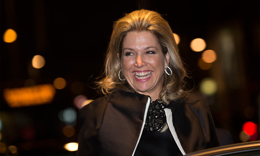 During an evening out, Maxima transformed a simple black dress into a show-stopping outfit with the addition of an oversized black stone necklace.