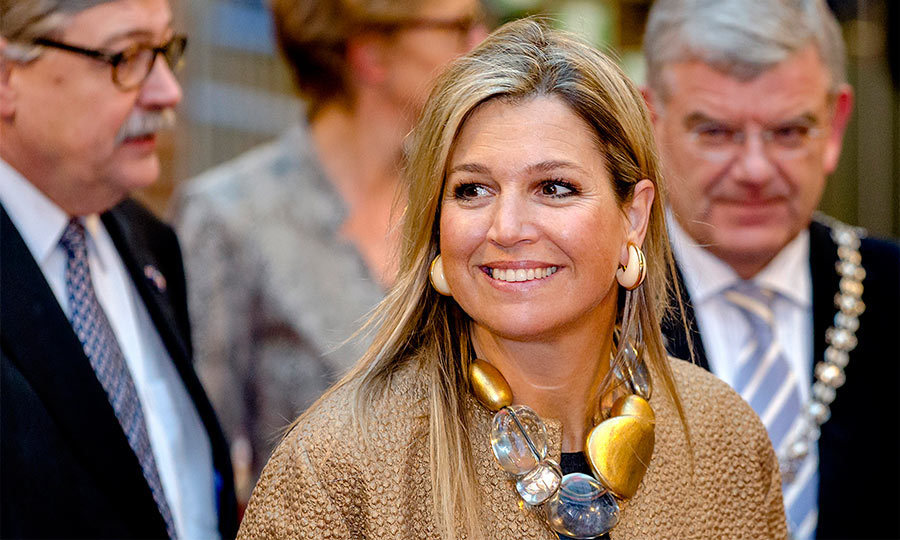 The mom of three proved that you can never have too many big accessories! M&aacute;xima rocked large cream earrings with a statement stone necklace during a royal engagement in Utrecht.
