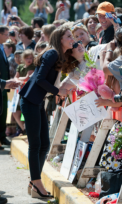 The Duchess of Cambridge has become a selfie queen thanks to the hundreds of photos she's posed in. Here she snaps a picture with a well-wisher in Slave Lake, Alberta. 