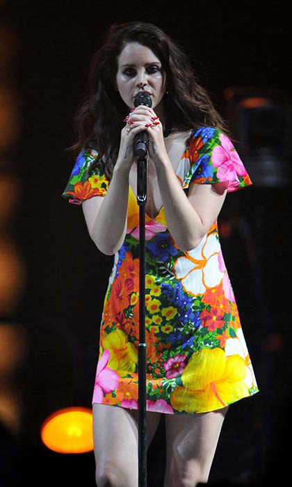Lana Del Ray chose a colourful printed dress for her performance during the 2014 festival.