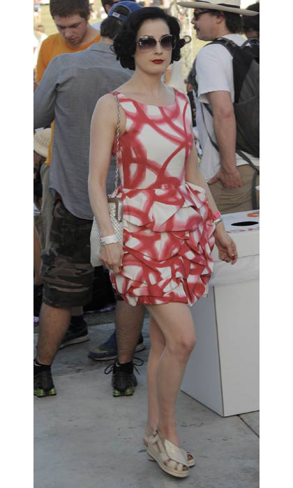 Dita Von Teese sported a gorgeous red and white dress when she attended the festival in 2009.