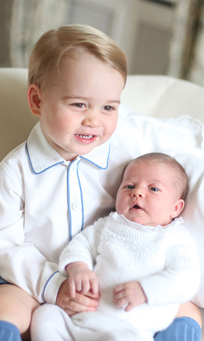 "Princess Charlotte will turn one on May 2 and is already taking her first steps. ""You hold her hand and she kicks [the ball]. Very sweet,"" William said.