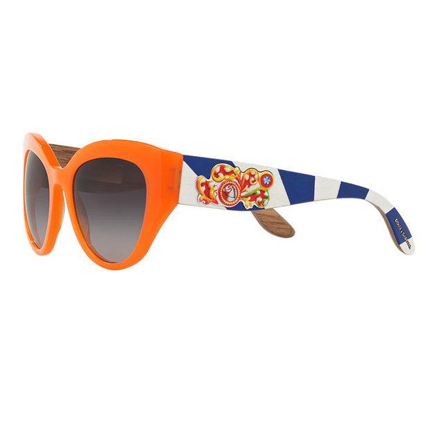 "Dolce & Gabbana Cat Eye in Orange/Grey, $990, <a href=""http://www.sunglasshut.com/ca/8053672582192"">sunglasshut.com</a>"