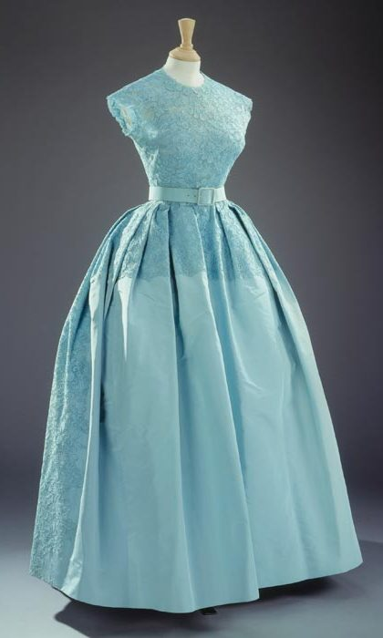 For the wedding of her sister Princess Margaret and Mr Antony Armstrong-Jones on 6 May 1960, the Queen wore this turquoise-blue dress with a matching bolero jacket of silk taffeta, guipure lace and silk tulle by Norman Hartnell.