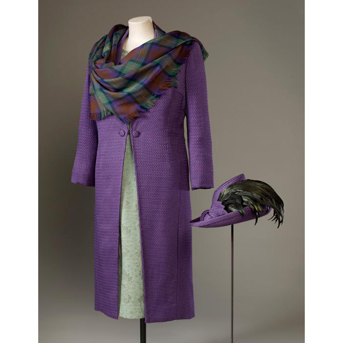 For the official opening of the Scottish Parliament on 1 July 1999, Her Majesty wore a purple coat made of a silk-wool blend with a green silk-crepe and lace dress, and a shawl of purple and green Isle of Skye tartan, woven on the Island of Lewis.