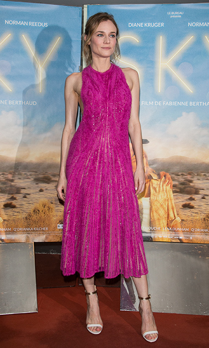 Diane Kruger is pretty in pink wearing a playful Hugo Boss party dress embellished with sequins at the Paris premiere of <em>Sky</em>. 