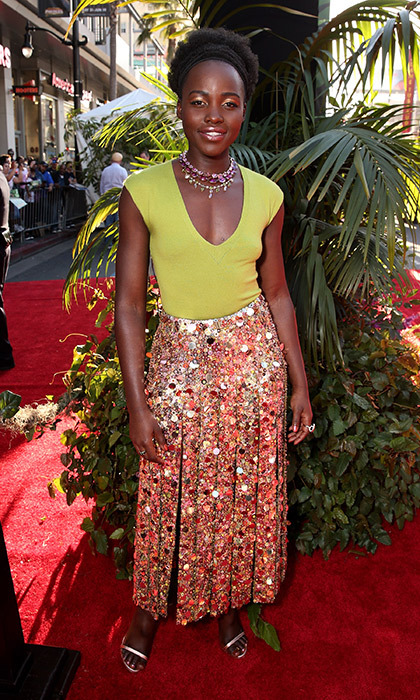 Lupita Wyong'o shined on the red carpet in a custom J. Crew green bodysuit and sequin-embellished slashed skirt, Stuart Weitzman sandals and Fred Leighton necklace at the premiere of <em>The Jungle Book</em> in Hollywood. 