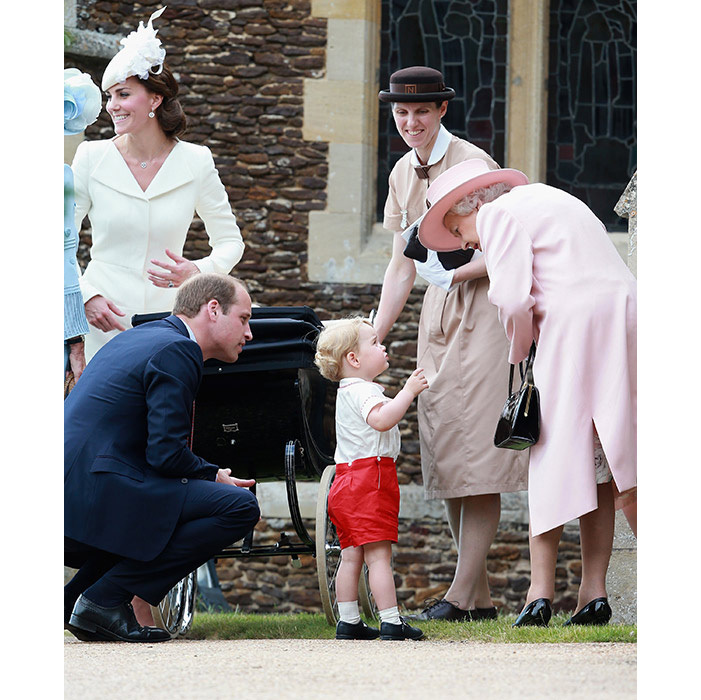 Prince George talking to the Queen at his baby sister's christening.