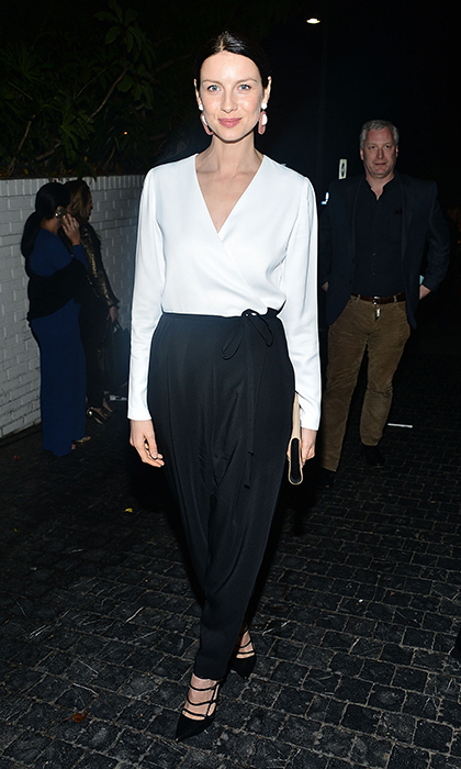 This Rosetta Getty tuxedo jumpsuit Caitriona wore to the Starz Pre-Golden Globe Celebration at Chateau Marmont in West Hollywood in January is award-winning to us. She completed the look with Tabitha Simmons shoes.