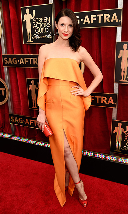 A pop of colour looks striking on the <i>Outlander</i> star. For the SAG Awards in 2015, she opted for a strapless, tangerine Solace dress with Gianvito Rossi shoes and a Rodo clutch.