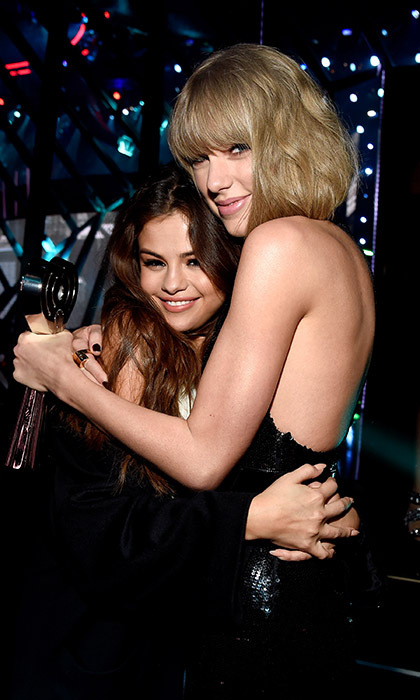 Selena Gomez helped best friend Taylor Swift celebrate her Album of the Year award at the iHeartRadio Music Awards in California. 