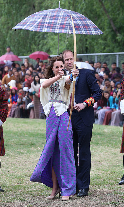 On their first day in Bhutan, Prince William and Kate took in a competitive archery match before being invited to try their hands at the country's national sport. The sporty duchess aimed her arrow at the target rather intensely before appearing highly amused as it veered off course. 