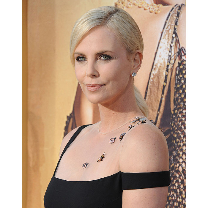 Charlize Theron turned heads at <em>The Huntsman: Winter's War</em> premiere where she wowed fans with her radiant complexion, opting for barely-there make-up save for the eyes where she rocked edgy, shimmering eyeshadow.