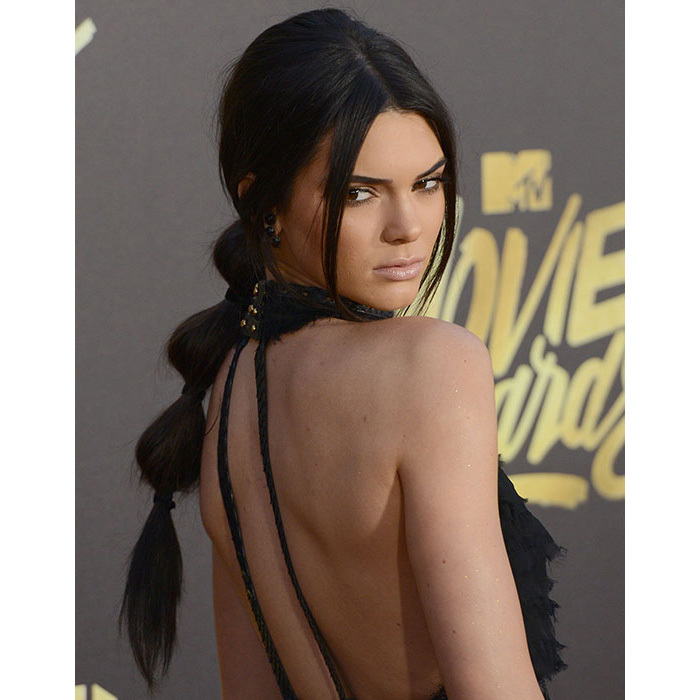 Kendall Jenner gave us serious ponytail goals with this 'bubble' hairstyle at the MTV Movie Awards – recreate the look by wrapping hairbands every few inches down a sleek ponytail.