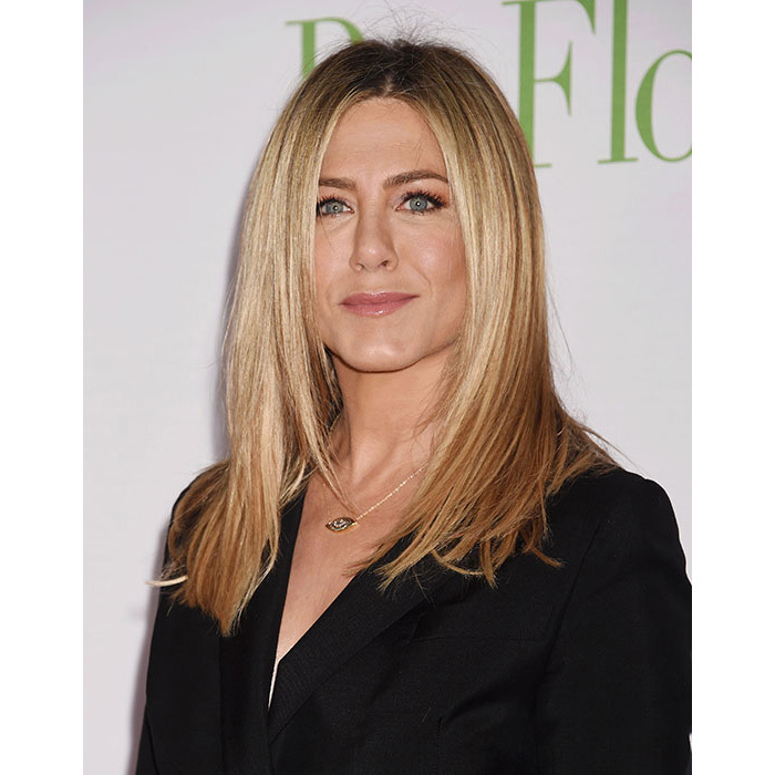 Jennifer Aniston had us reaching for the straighteners as she stepped out for the Mother's Day premiere, where she rocked poker straight locks. The star also showed off her beauty credentials, complementing her shimmering eyeshadow with pale pink glossy lips.