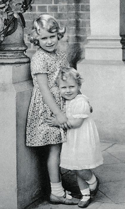 The future Queen Elizabeth II, seen here aged six, with her younger sister Princess Margaret, aged two.