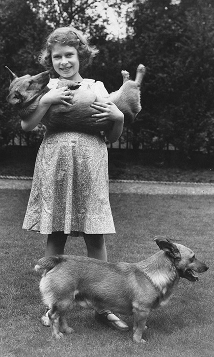 Princess Elizabeth with two corgi dogs at her home at 145 Piccadilly, London, July 1936.