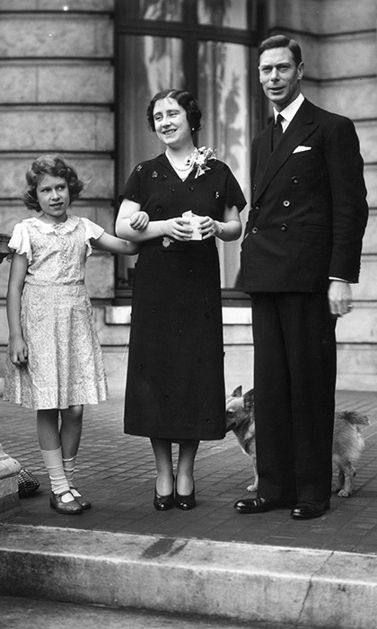 George, Duke of York and Elizabeth, Duchess of York with their daughter Princess Elizabeth on the terrace at 145 Piccadilly, London, their home before the Duke's accession to the throne.