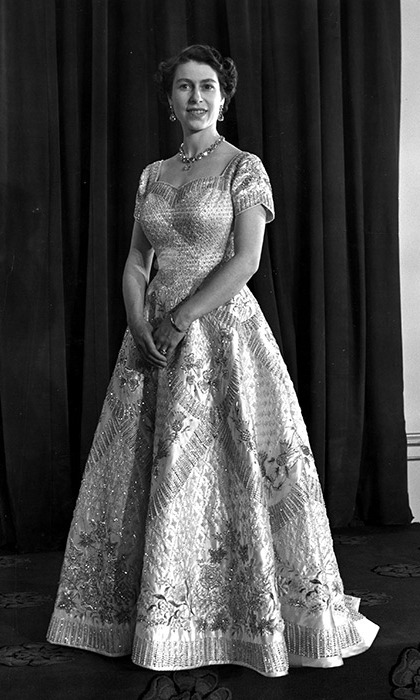 Queen Elizabeth II wearing a gown designed by Norman Hartnell for her Coronation ceremony in 1953.