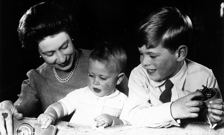 Queen Elizabeth II plays with Princes Edward and Andrew at Windsor Castle.