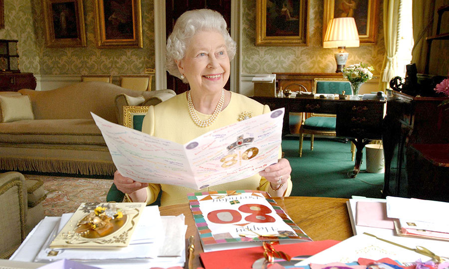 Queen Elizabeth II sits in the Regency Room at Buckingham Palace in London, April 20, 2006, as she looks at some of the cards which have been sent to her for her 80th birthday.