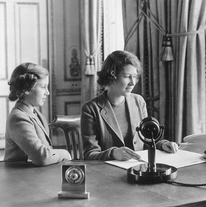 Princess Elizabeth makes her first broadcast, accompanied by her younger sister Princess Margaret Rose October 12, 1940 in London.
